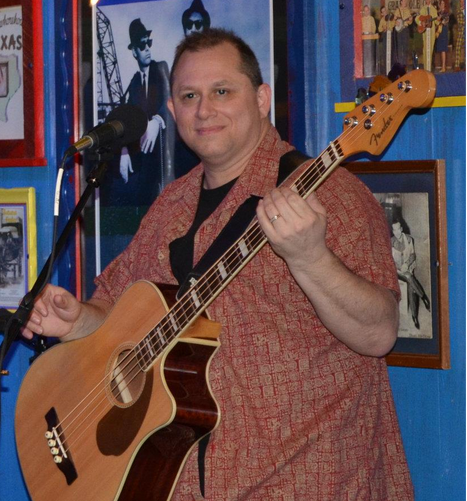 John M. Hoyt on acoustic bass guitar